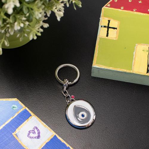 Rhodium plated alloy key ring, white and grey enamel evil eye