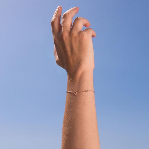 Βραχιόλι ζώδιο αστερισμός του Κριού (Κριός), ροζ επιχρυσωμένο ασήμι 925, λευκά ζιργκόν και μονόπετρο.