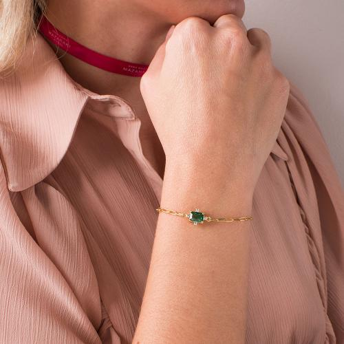 Yellow gold plated sterling silver bracelet, rectangle green solitaire and white cubic zirconia.