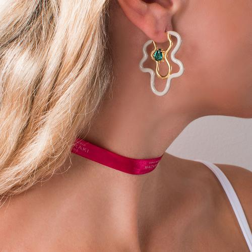 Yellow gold plated sterling silver hoops, beige enamel and green cubic zirconia.