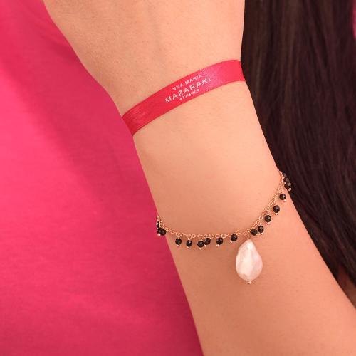 Βραχιόλι ροζ επιχρυσωμένο μέταλλο, μαύρες ημιπ. πέτρες και μαργαριτάρι.