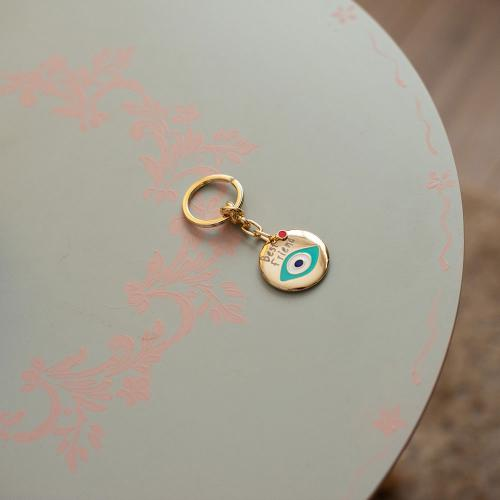 Yellow gold plated alloy key ring, white and turquoise enamel with evil eye.