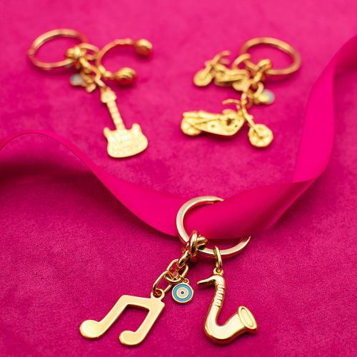 Yellow gold plated alloy key ring, turquoise enamel evil eye, musical note and saxophone.