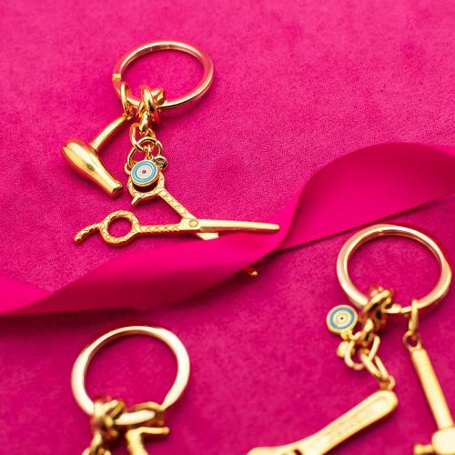 Yellow gold plated alloy key ring, turquoise enamel evil eye, scissors and hairdryer.