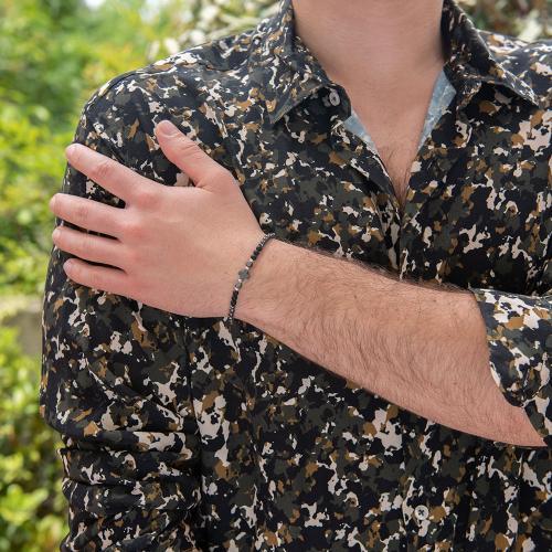 Black macrame bracelet, hemitite (semi precious stone) and black rhodium plated alloy cross.