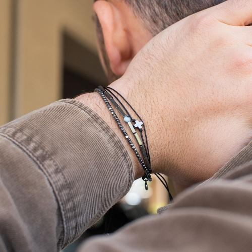 Black macrame bracelet, hemitite, black rhodium plated alloy cross and evil eye.