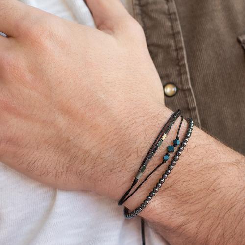 Black macrame bracelet, hemitite, black rhodium plated alloy crosses.