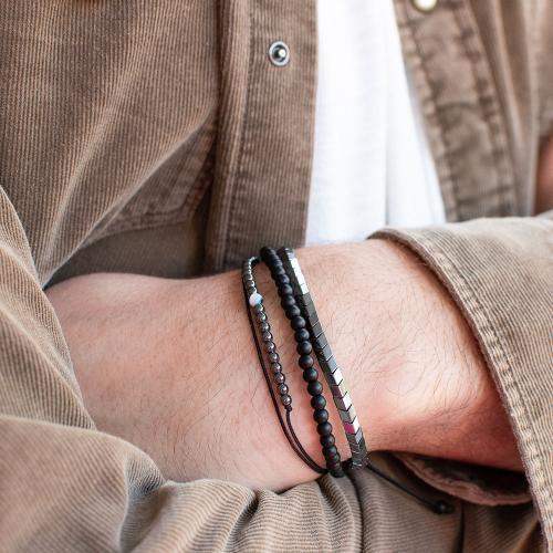 Black macrame bracelet, hemitite, black rhodium plated alloy arrows and evil eye.