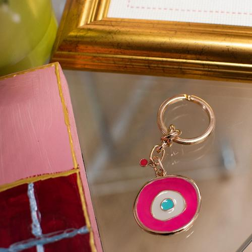Rose gold plated alloy key ring, fuchsia evil eye.